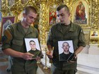 Kyiv paid tribute to national guards killed in explosion outside parliament year ago. PHOTOS